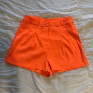 High waisted neon orange shorts